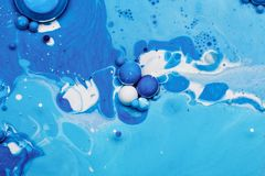 Abstract background from blue paints and oil Stock Photography