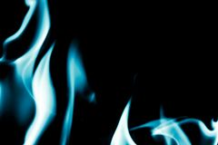Abstract background of blue flame fire on black background Royalty Free Stock Photos
