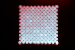 Abstract background, blue and red bokeh on a black in the form of square royalty free stock image