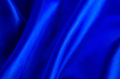 Abstract background - Blue satin textile royalty free stock photos