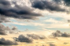Abstract background, blue sky with dark cumulonimbus clouds. Abstract background, blue sky with dark cumulonimbus and stormy clouds before rain, in soft blurred Royalty Free Stock Photos