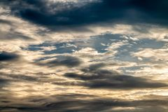 Abstract background, blue sky with dark cumulonimbus clouds. Abstract background, blue sky with dark cumulonimbus and stormy clouds before rain, in soft blurred Stock Photo