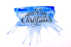 Abstract background blue tone and the text of Merry Christmas. Lettering calligraphy.  Stock Photo