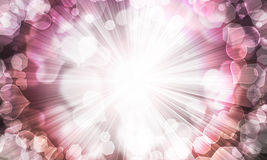 Abstract background of blurred. Lights in the shape of the heart and shining rays Stock Photo