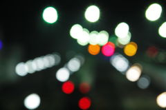 Abstract background of blurred city lights with bokeh effect Stock Image