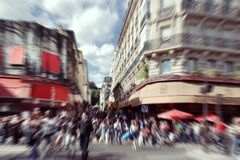 Abstract background.  Blurred crowd in  Paris - radial zoom blur Royalty Free Stock Photo
