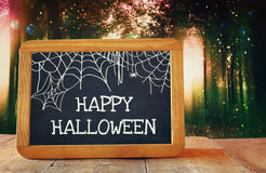 Abstract background of blurred forest and blackboard. Abstract and mysterious background of blurred forest and blackboard. Filtered image. Halloween concept Stock Images