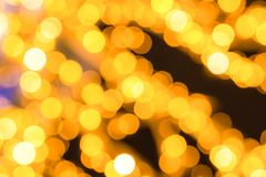 Abstract background blurred light garland festive set of spots golden colorful base colorful stock image