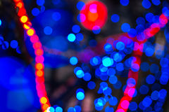 Abstract background of blurred lights with bokeh effect. Abstract background of blurred warm red  and cool blue lights with bokeh effect Stock Image