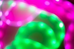 Abstract background of blurred neon green and pink lines. stock image