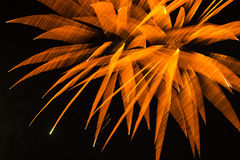Abstract Background: Blurred Orange Fireworks. Exiting the field of view in a pure black sky, blurred tapering orange lines with white lit tips overlap to form Stock Images