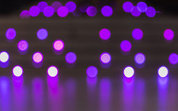 Abstract background of blurred purple color lights with bokeh effect Royalty Free Stock Photos