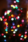 Abstract Background of Blurred Rainbow Colored Christmas Tree Li royalty free stock photography