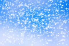 Abstract background of blurred snow storm on blue sky Stock Photography