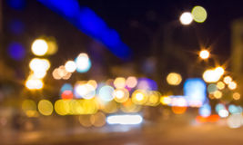 Abstract background of blurred street city lights. Abstract background of blurred street warm city lights with cool blue and purple background with bokeh effect Royalty Free Stock Image