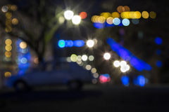 Abstract background of blurred street city lights. Abstract background of blurred street warm, cool blue and purple city lights with bokeh effect Royalty Free Stock Photography