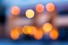 Abstract background of blurred lights with bokeh effect. Abstract background of blurred warm Stock Images