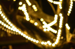 Abstract background with bokeh defocused lights - image of defocused lights on the tree Royalty Free Stock Images