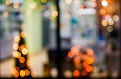 Abstract background of blurred lights in window. Abstract background with bokeh effect of blurred warm lights in window of a shop stock photography