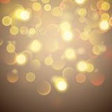 Abstract background with bokeh effect in gold Royalty Free Stock Images