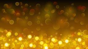 Abstract background with bokeh effect in gold Royalty Free Stock Photo