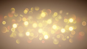 Abstract background with bokeh effect in gold Stock Image