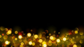 Abstract background with bokeh effect in gold Royalty Free Stock Image