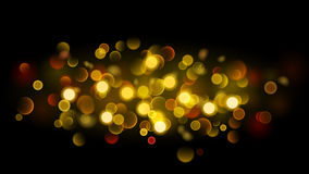 Abstract background with bokeh effect in gold Stock Photos