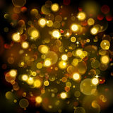 Abstract background with bokeh effect in gold Stock Images