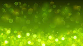 Abstract background with bokeh effect in green. Abstract background with bokeh effect. Blurred defocused lights in green colors Royalty Free Stock Photography