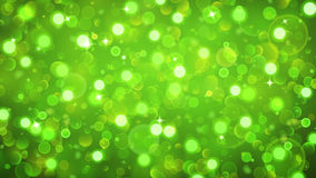 Abstract background with bokeh effect in green. Abstract background with bokeh effect. Blurred defocused lights in green colors. Bokeh lights with sparkles Stock Photo