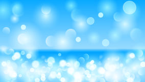 Abstract background with bokeh effect in light blue Royalty Free Stock Photo