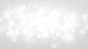 Abstract background with bokeh effect in white. Abstract background with bokeh effect. Blurred defocused lights in white colors. White bokeh lights on gray Stock Photos