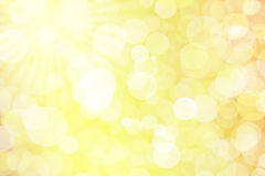 Abstract background with bokeh lights. Yellow background with bokeh lights Royalty Free Stock Photos