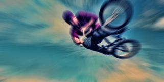 Abstract background . Boy on a BMX mountain bike jumping. Motion Royalty Free Stock Image