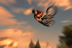 Abstract background . Boy on a BMX mountain bike jumping. Motion Stock Photo