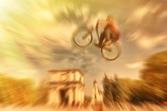 Abstract background . Boy on a BMX mountain bike jumping. Motion Stock Photography
