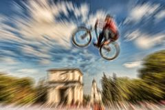 Abstract background . Boy on a BMX mountain bike jumping. Motion Stock Image