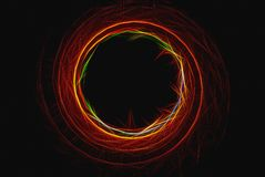 Abstract background of bright colored spiral on dark background. Abstract background of colored spiral on dark background Royalty Free Illustration