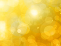 Abstract background - bright lights in darkness. Bright gold lights Royalty Free Stock Photo