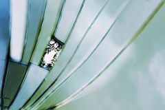 Abstract background, broken mirror shows blue turquoise sky colo. Rs and the reflection of willow leaves on one shard as in a window, selected focus royalty free stock images