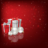 Abstract background with Christmas decorations and gifts. Abstract red background with Christmas decorations and gifts Stock Photo