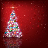 Abstract background with Christmas tree and decorations. Abstract red background with Christmas tree and decorations Stock Image
