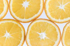 Abstract background with citrus-fruit of orange slices. Close-up. Studio photography. Royalty Free Stock Photo
