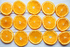 Abstract background with citrus-fruit of orange slices close-up on white wooden background Stock Photos