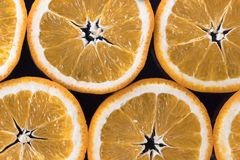 Abstract background with citrus-fruit of orange slices. Dark background. Close-up. Studio photography. Stock Image