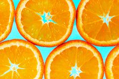 Abstract background with citrus-fruit of orange slices. Light blue background. Close-up. Studio photography. Stock Photography