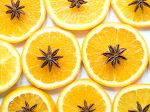 Abstract background with citrus fruit of orange slices and star anise. Royalty Free Stock Image