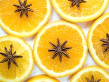 Abstract background with citrus fruit of orange slices and star anise. Stock Photo