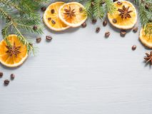 Abstract Christmas background with citrus fruit, slices of orange and star anise. Copy space Royalty Free Stock Image